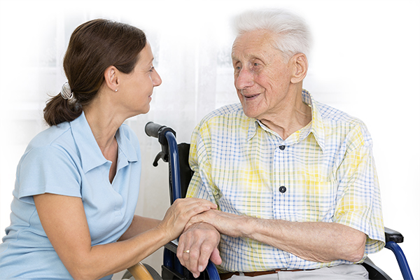 Caregiver speaking with senior man.